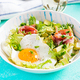 Ketogenic, paleo diet. Fried egg, prosciutto, avocado and fresh salad on blue table. - PhotoDune Item for Sale