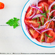 Fresh tomatoes with red onion and spices in a blue bowl - PhotoDune Item for Sale