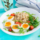 Breakfast oatmeal porridge with boiled egg, cherry tomatoes and arugula. Healthy balanced food. - PhotoDune Item for Sale