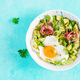 Ketogenic, paleo diet. Fried egg, prosciutto, avocado and fresh salad on blue table - PhotoDune Item for Sale