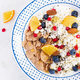 Bowl of flakes with cottage cheese and yogurt, blueberryes and pomegranate - PhotoDune Item for Sale