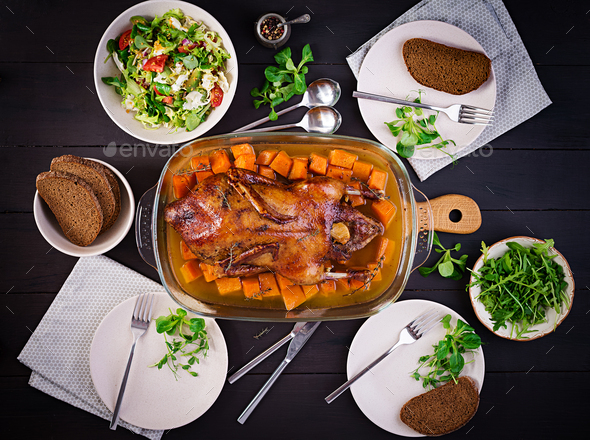 Thanksgiving or Christmas dinner. Roast duck with thyme and pumpkin - Stock Photo - Images