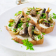 Sandwich - smorrebrod with sprats, green olives and butter on light table. Danish cuisine. - PhotoDune Item for Sale