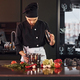 Using equipment. Professional young chef cook in uniform working on the kitchen with vegetables - PhotoDune Item for Sale