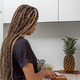 Woman having breakfast in home kitchen - PhotoDune Item for Sale