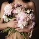 Half-naked middle age brunette caucasian model with peonies studio shot - PhotoDune Item for Sale