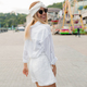Funny charming lady in white summer outfit walking down the street and having fun in summer city - PhotoDune Item for Sale