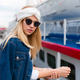 Stylish american woman with blond hair wearing sunglasses and denim jacket - PhotoDune Item for Sale