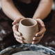 Hands of a potter, creating an earthen jar on the circle - PhotoDune Item for Sale