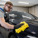 Master finish washing car and wiping the side by microgiber cloth at a car workshop - PhotoDune Item for Sale