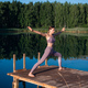 Healthy woman practicing yoga on the lake at sunrise enjoying positive energies from nature - PhotoDune Item for Sale