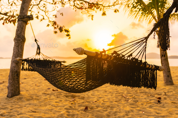 Empty hammock swing around beach sea ocean at sunset or sunrise time - Stock Photo - Images