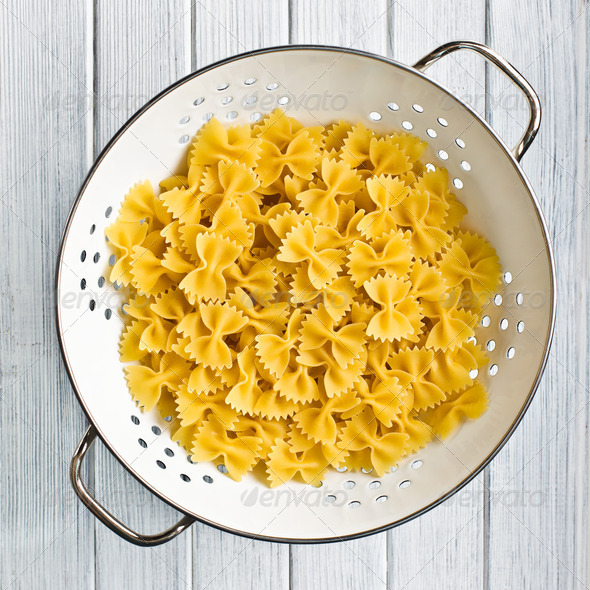 pasta farfalle in strainer - Stock Photo - Images
