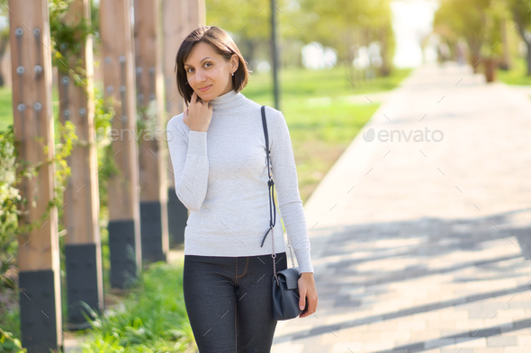 Attractive young woman enjoying in park - Stock Photo - Images