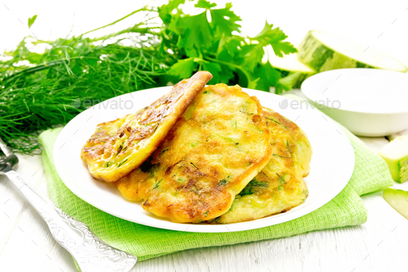 Pancakes of zucchini on towel - Stock Photo - Images