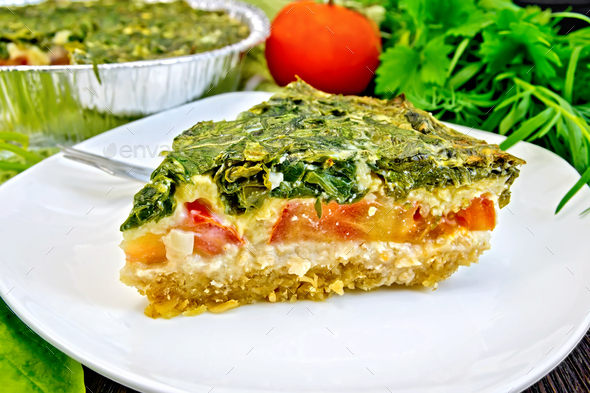 Pie celtic with spinach and tomatoes on board - Stock Photo - Images