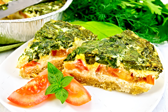 Pie celtic with spinach in plate on board - Stock Photo - Images