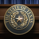 Symbol and big seal of State of Texas on the tribune. - PhotoDune Item for Sale