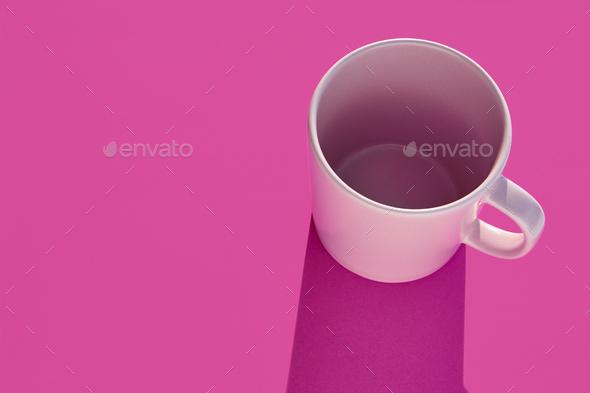 Pink mug over a purple background. Morning breakfast. Design porcelain - Stock Photo - Images