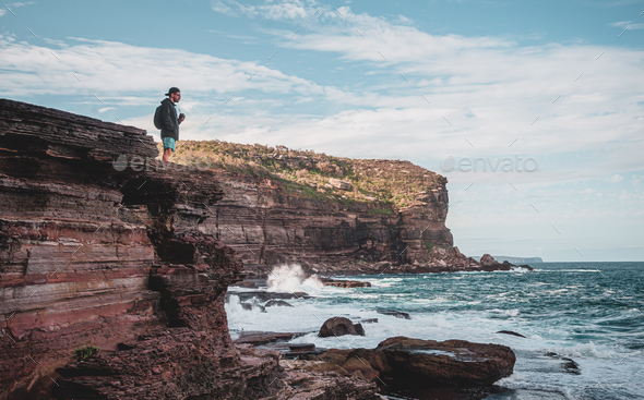 Young Tourist With Backpack Standing on the Edge of Cliff. Outdoor Adventure.Sydney,Australia. - Stock Photo - Images