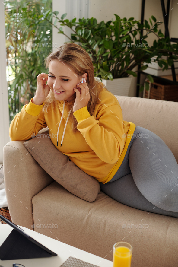 Woman video calling friends - Stock Photo - Images