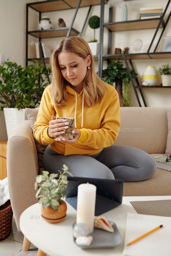 Young woman with scented candle - Stock Photo - Images