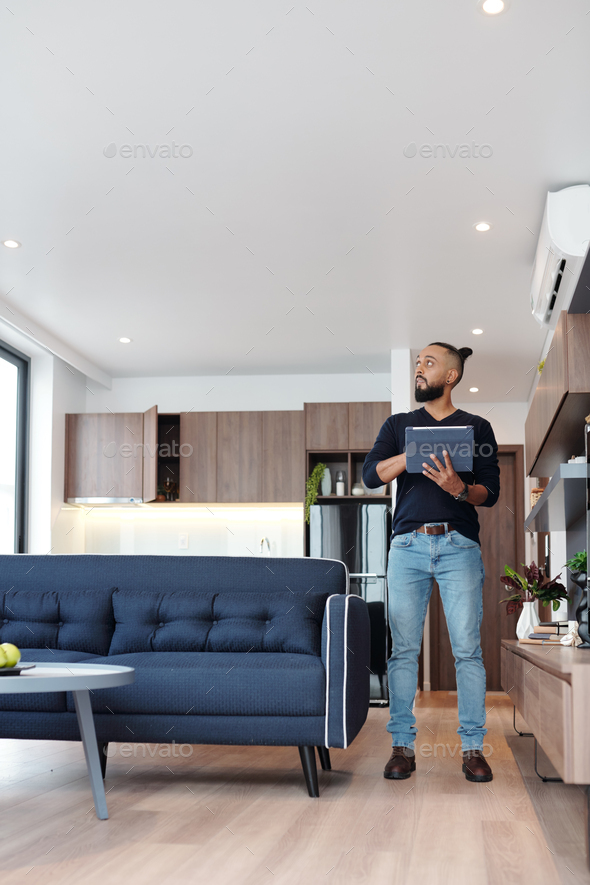 Man using smart house app - Stock Photo - Images