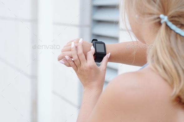 Jogger checking fitness trekker - Stock Photo - Images
