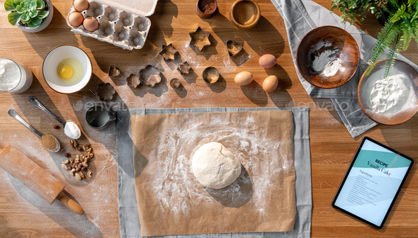 Flat lay top view of dough and baking ingredients, desktop concept - Stock Photo - Images