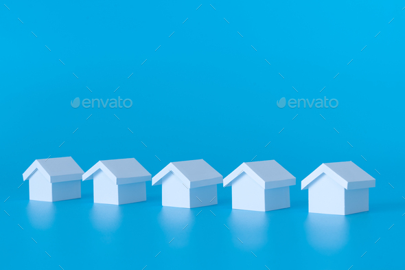 Real estate property concept using miniature white houses - Stock Photo - Images