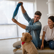 Happy family playing with their dog at home. People animal pet love concept - PhotoDune Item for Sale