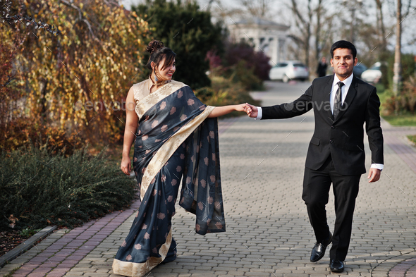 Elegant and fashionable indian friends couple - Stock Photo - Images