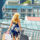 Happy shopper with shopping bags in SIngapore - PhotoDune Item for Sale
