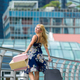 Beautiful woman carry their bags to the city - PhotoDune Item for Sale