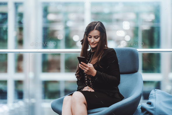 A business lady using her smartphone - Stock Photo - Images