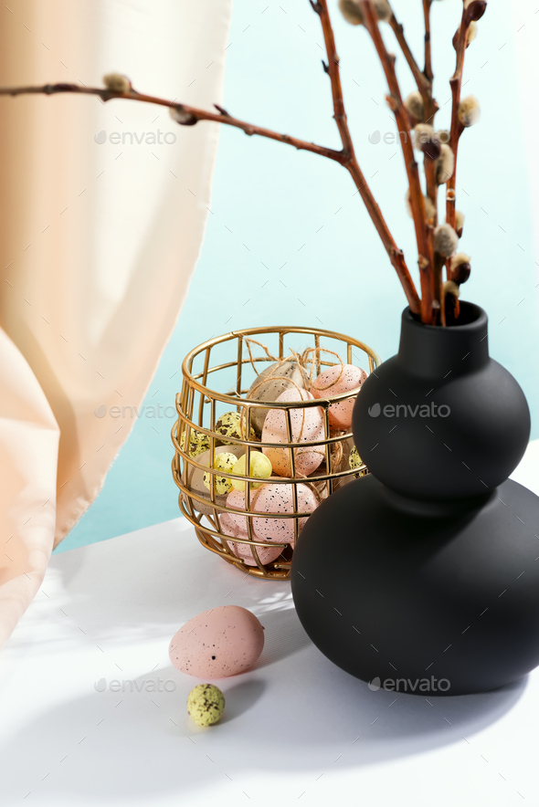 Happy Easter eggs and branches seals in a vase with drapery fabric - Stock Photo - Images