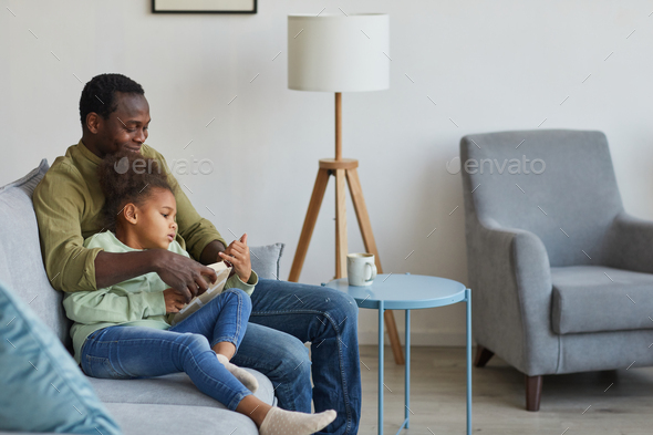Father and Daughter Relaxing at Home Together - Stock Photo - Images