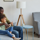 Father and Daughter Relaxing at Home Together - PhotoDune Item for Sale