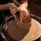 Female Hands on Pottery Wheel in Sunlight - PhotoDune Item for Sale