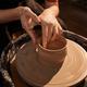 Female Hands on Pottery Wheel in Sunlight - PhotoDune Item for Sale