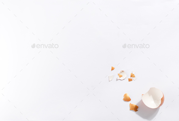Scattered gold eggs, shell on pastel beige background - Stock Photo - Images