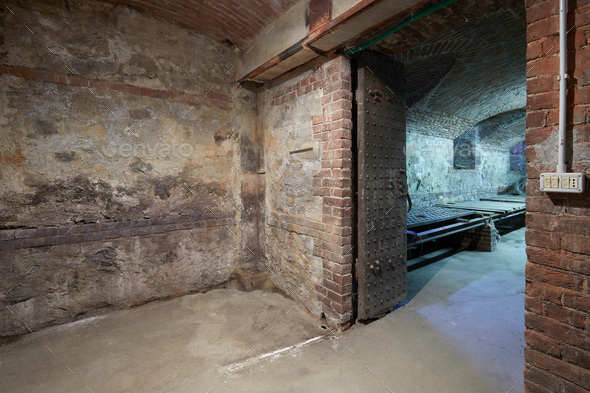 Old, empty basement with brick walls and wooden portal - Stock Photo - Images