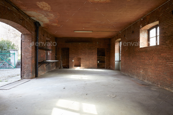 Old, empty workshop interior with brick walls - Stock Photo - Images