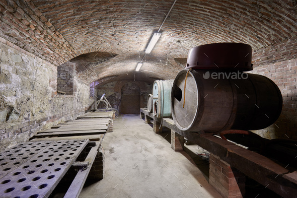 Old cellar with wooden barrels and brick ceiling - Stock Photo - Images