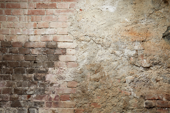 Old brick and cement wall with black burned part - Stock Photo - Images