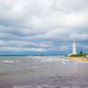 White lighthouse in a bay at sea - PhotoDune Item for Sale