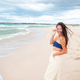 Young woman on the beach in the storm - PhotoDune Item for Sale