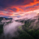 Mountains in low clouds at sunset in summer. Aerial view - PhotoDune Item for Sale
