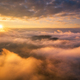 Mountains in clouds at sunrise in summer. Aerial view - PhotoDune Item for Sale