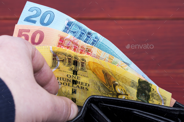 Money from Fiji in the black wallet - Stock Photo - Images